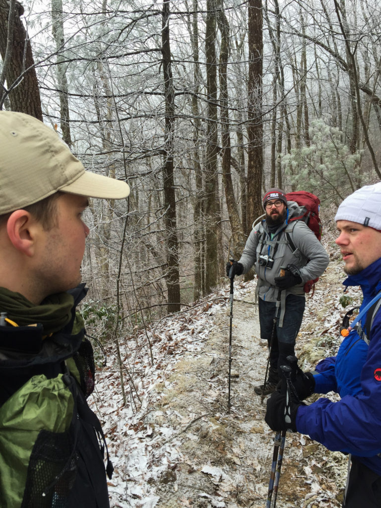 hikers at the start of the Appalachian trail in snow