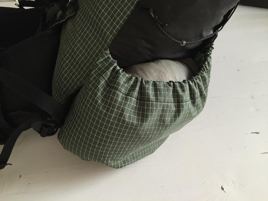 tent in side pocket of backpack