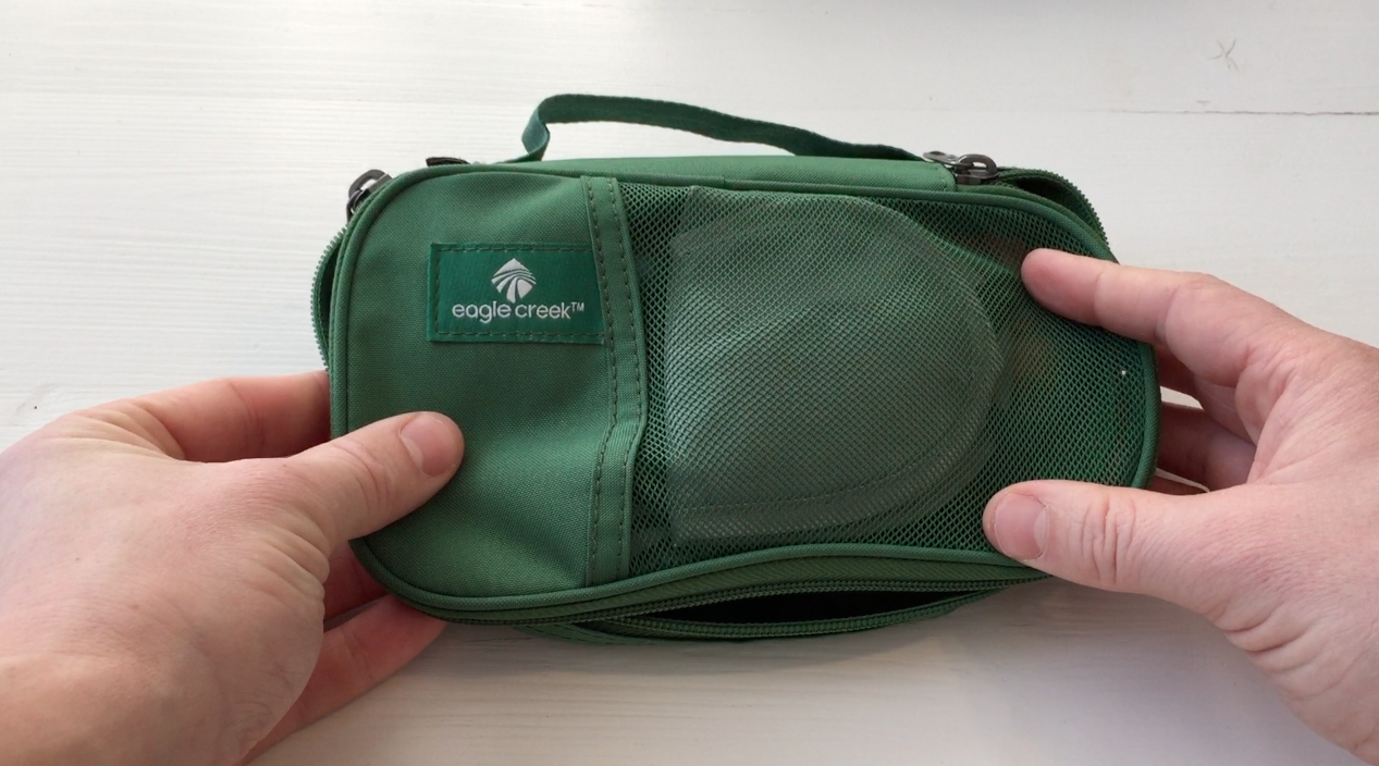 small green packing cube
