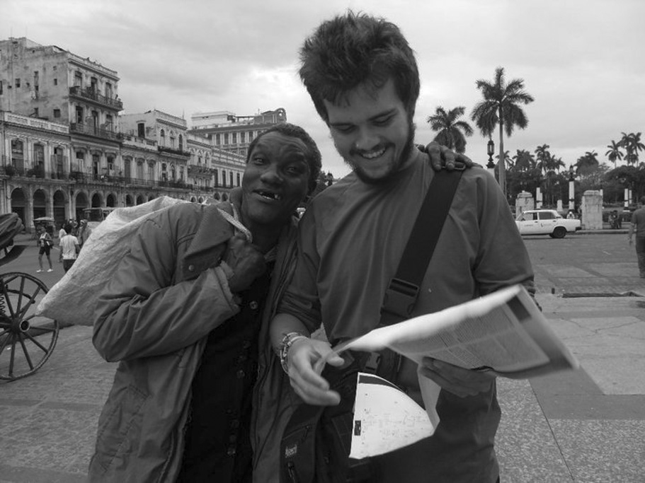 traveller with homeless man in havana cuba