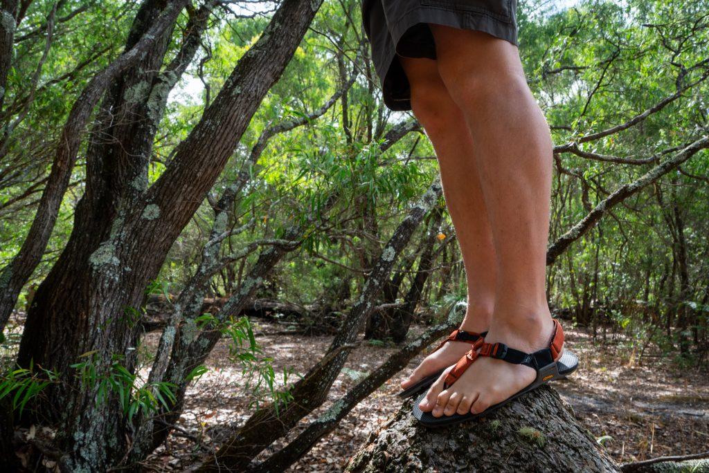 balancing on a log wearing sandals