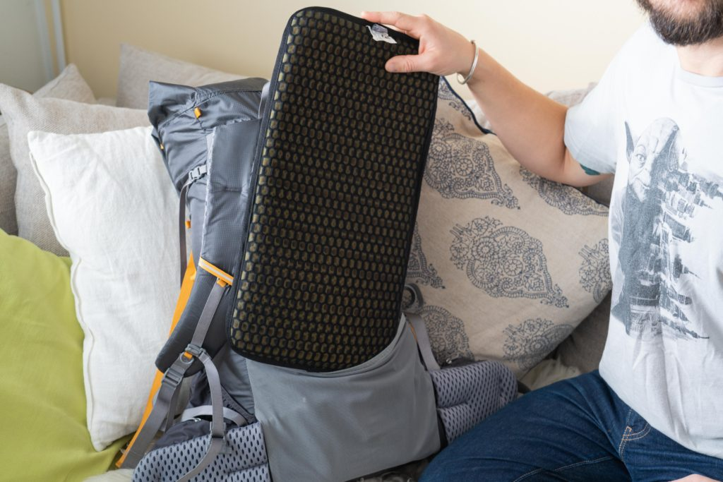 removing the sit pad from the backpack
