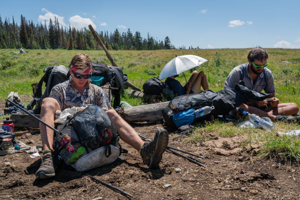 three hikers taking a break on the continental divide trail