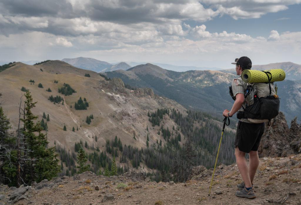 solo hiker enjoying a view
