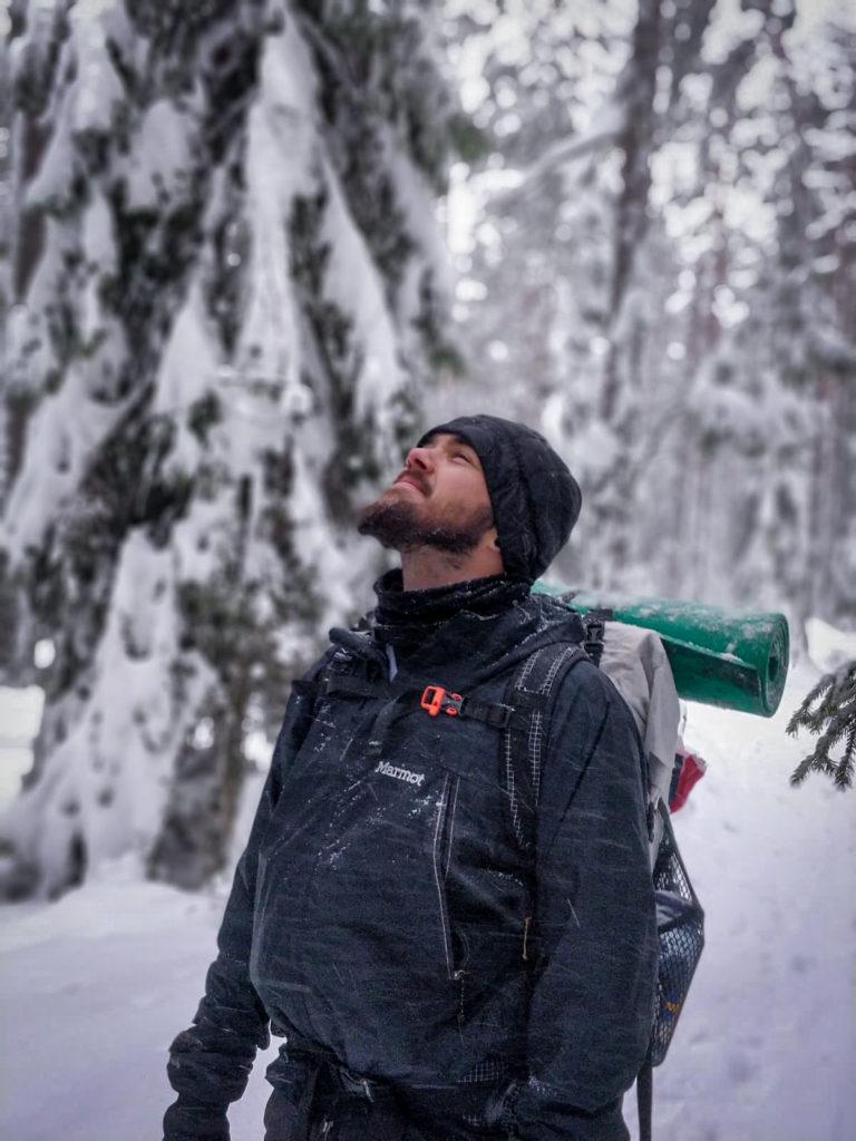man enjoying winter backpacking in Finland